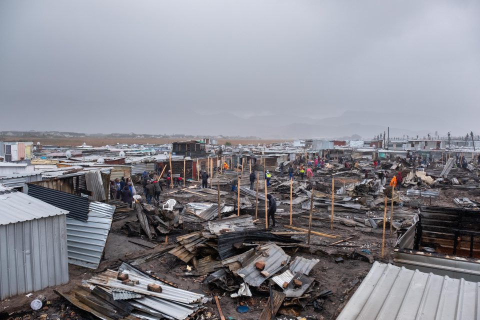 2 August 2019: The fire that swept through Section E of Masiphumelele near Cape Town at the end of July left a burnt hollow almost the size of a football pitch in the middle of the township.