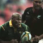 19 August 2000: Springbok wing Chester Williams charges away from New Zealand's Jonah Lomu to score the opening try during a Tri Nation Rugby Union International game at Ellis Park in Johannesburg, South Africa. (Photograph by David Rogers/Allsport)