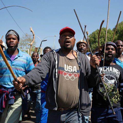 8 September 2019: A large group of men from inner-city hostels met with Mangosuthu Buthelezi in Malvern, Joburg, but did not respond well when he tried to dissuade them from participating in 'purely xenophobic' violence. (Photograph by James Oatway)