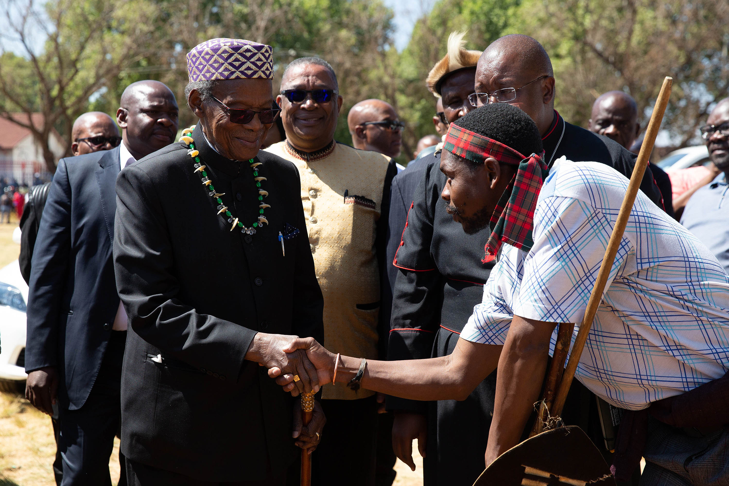 8 September 2019: Mangosuthu Buthelezi greeting a Joburg hostel dweller as he arrived at the gathering of men to discuss the violence taking place in the city. (Photograph by James Oatway)