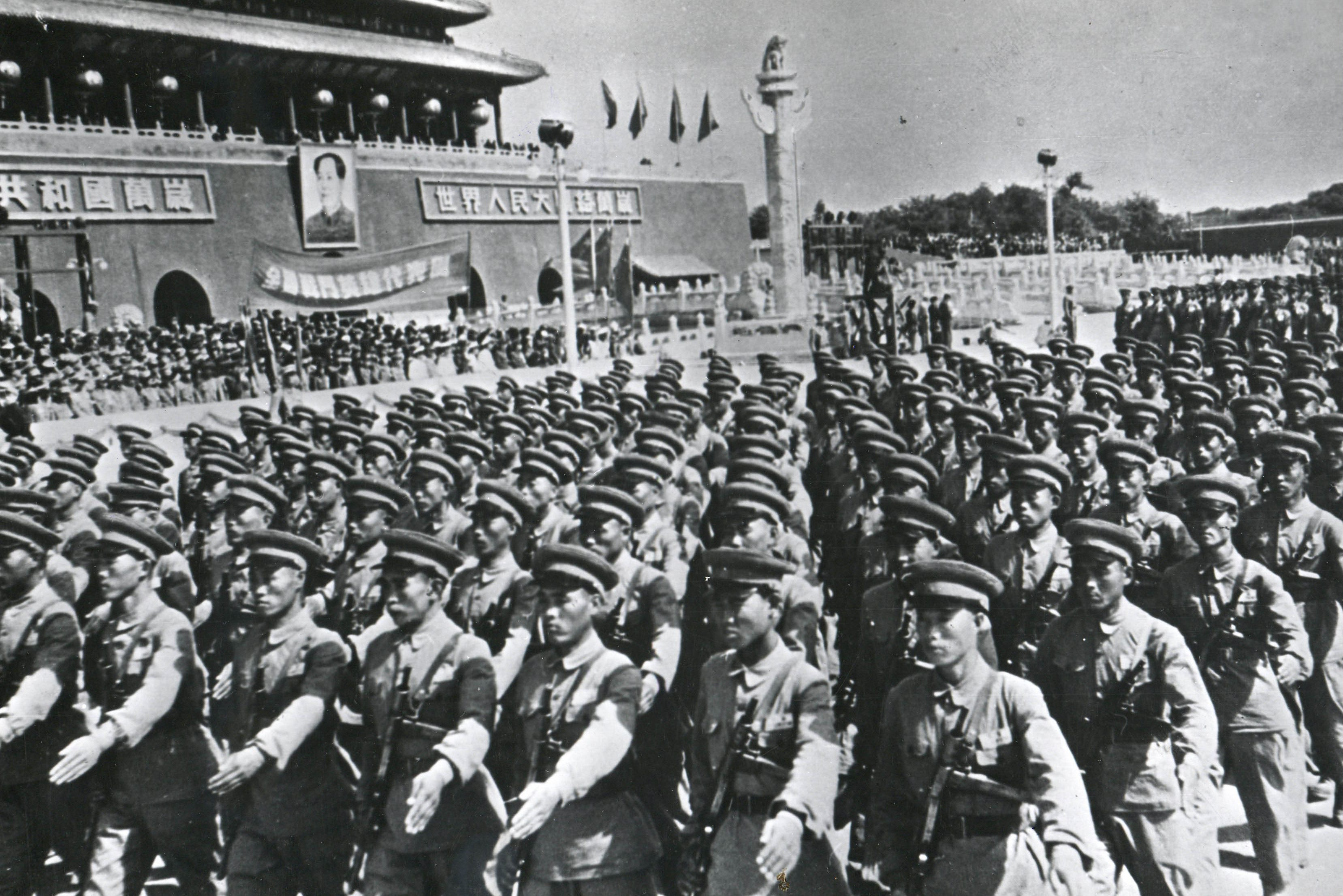 1950: A parade of the Red Army passing in front of Mao Zedong, who, like Vladimir Lenin, based his political and military analyses on the irreconcilable difference between attack and defence. (Photograph by PhotoQuest/Getty Images)