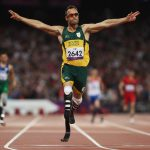 8 September 2012: Just five months before killing Reeva Steenkamp, Oscar Pistorius celebrates as he wins gold in the Men's 400m T44 Final at the London 2012 Paralympic Games in London. (Photograph by Michael Steele/Getty Images)