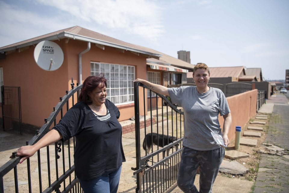 5 September 2019: Celeste Cameron, Nathalie van Rooyen (right) and other women banded together to prevent the Somali-run spaza shop on their street in Coronationville from being looted by a xenophobic mob.