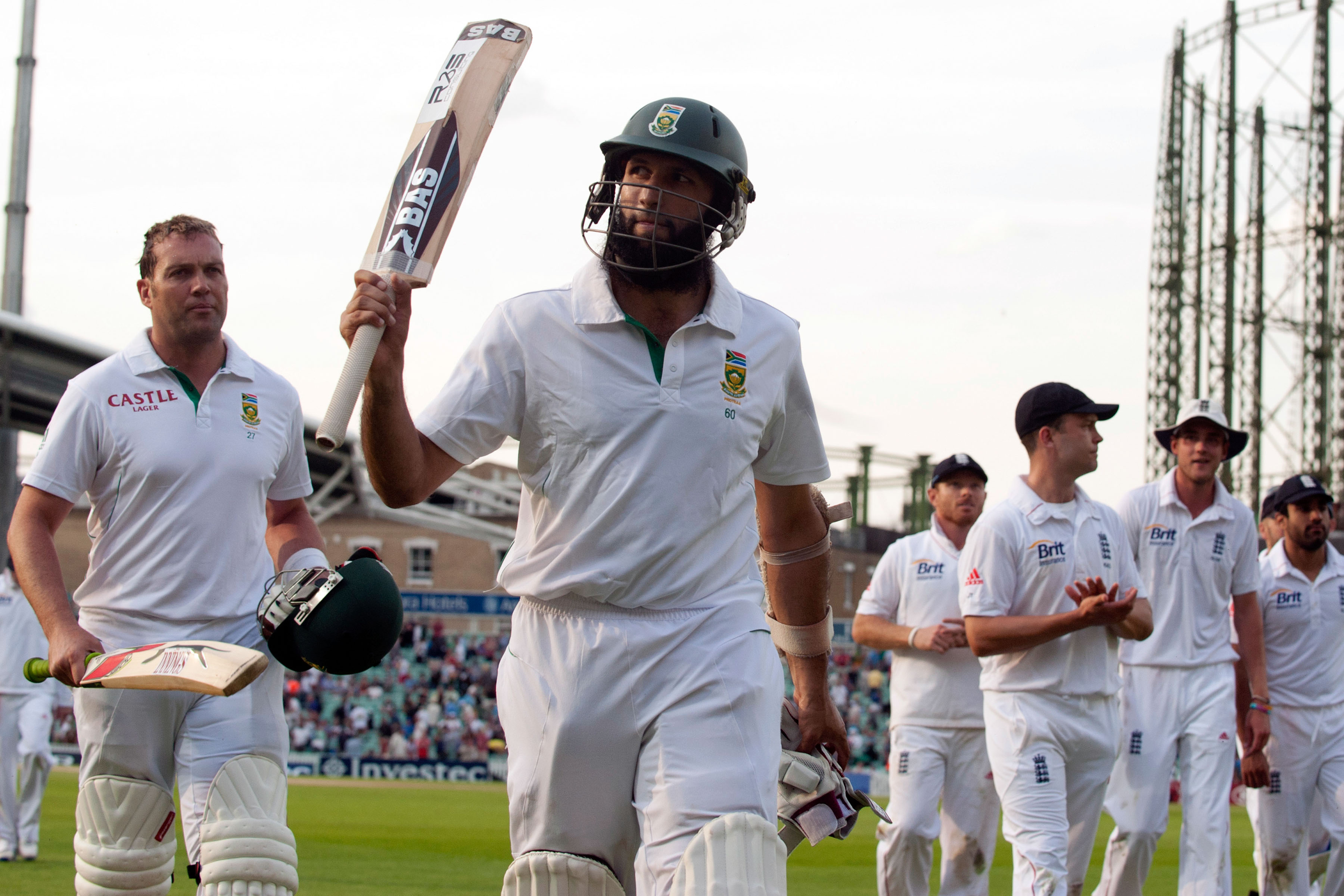 21 July 2012: Jacques Kallis (left) and Hashim Amla (second from left) leaving the field at The Oval in London, England. Amla scored a triple Test century during the first Test of this series against England and is still the only South African to do so. (Photograph by Reuters/Philip Brown)