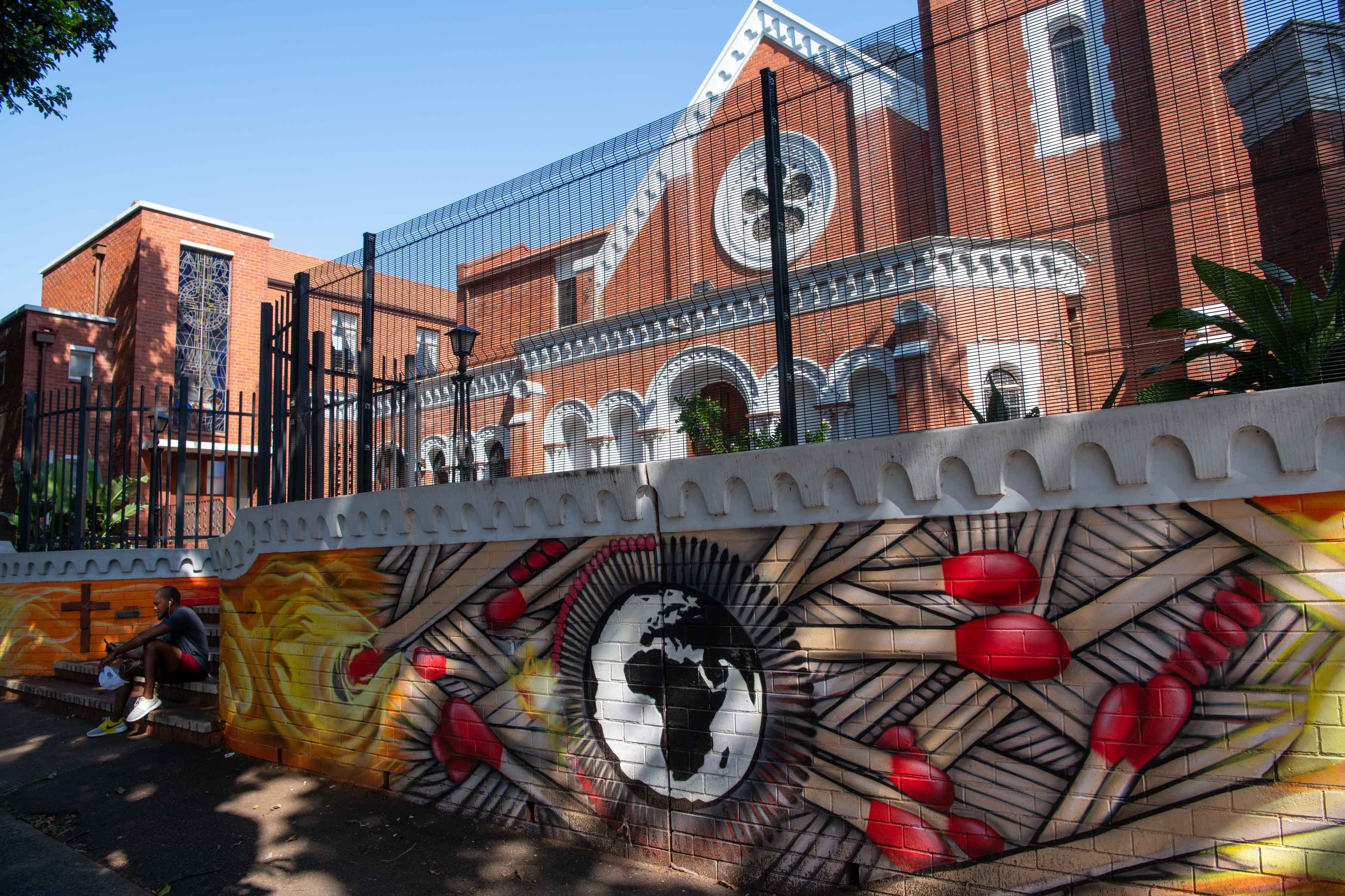 11 September 2019: Street artist Ewok was hired to create a mural on the perimeter wall of the church, which is a heritage site, creating outrage in the community.
