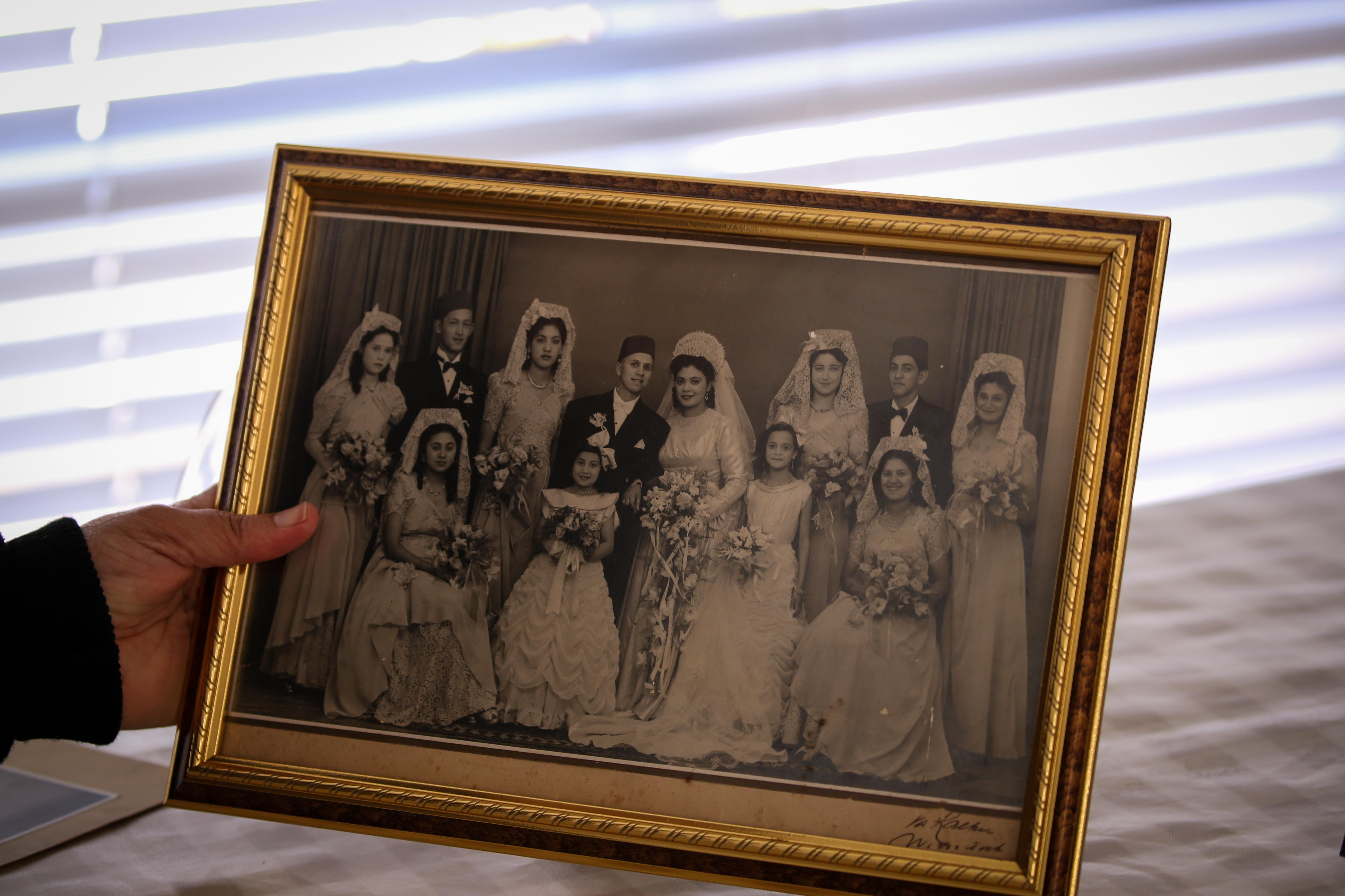12 September 2019: Fatima Haron-Masoet, daughter of Imam Haron, holds a framed photo of her parents' wedding at the family home in Athlone, Cape Town.