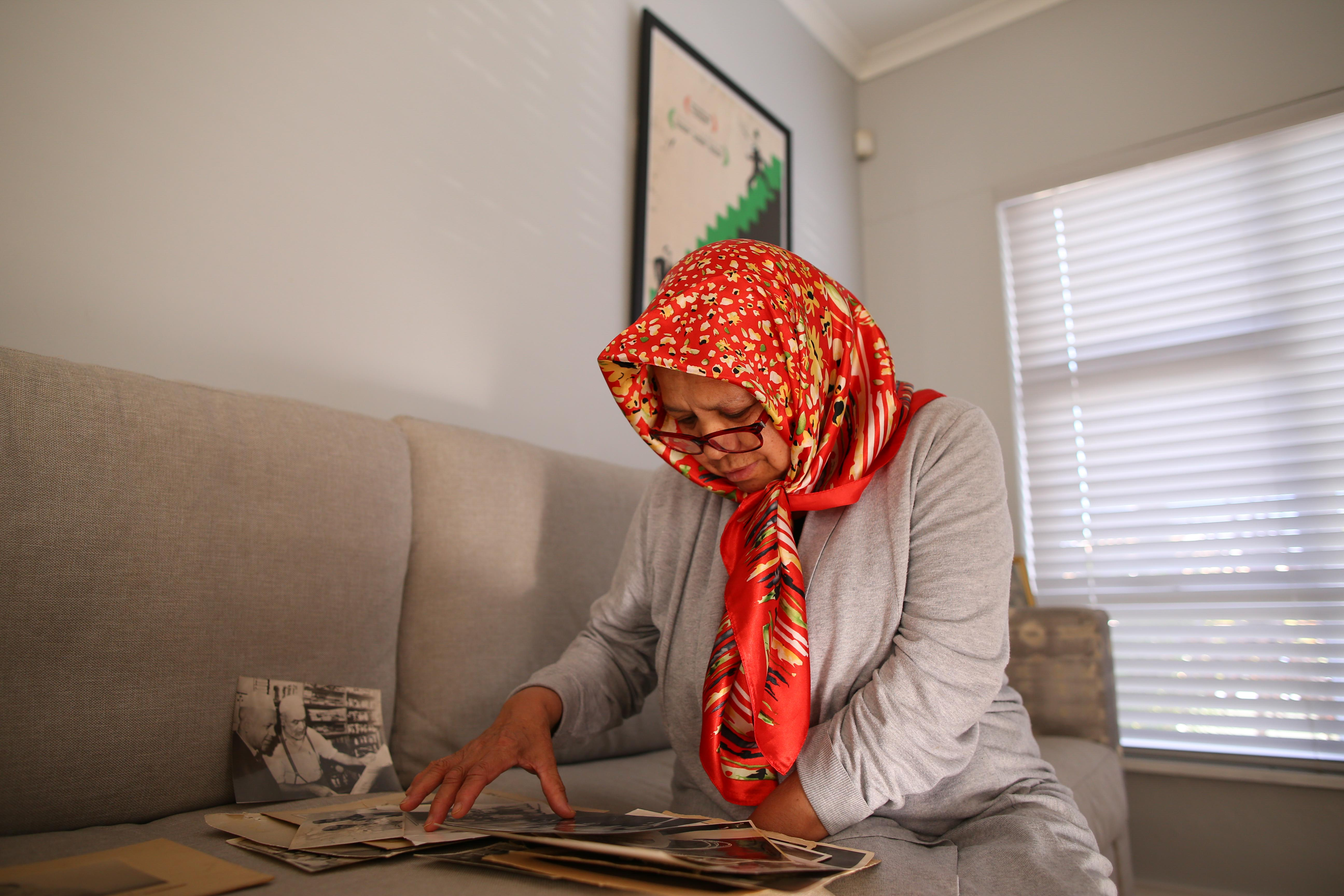 12 September 2019: Shamila Haron, Imam Haron's daughter, looks at old family photographs at the family home in Athlone, Cape Town.