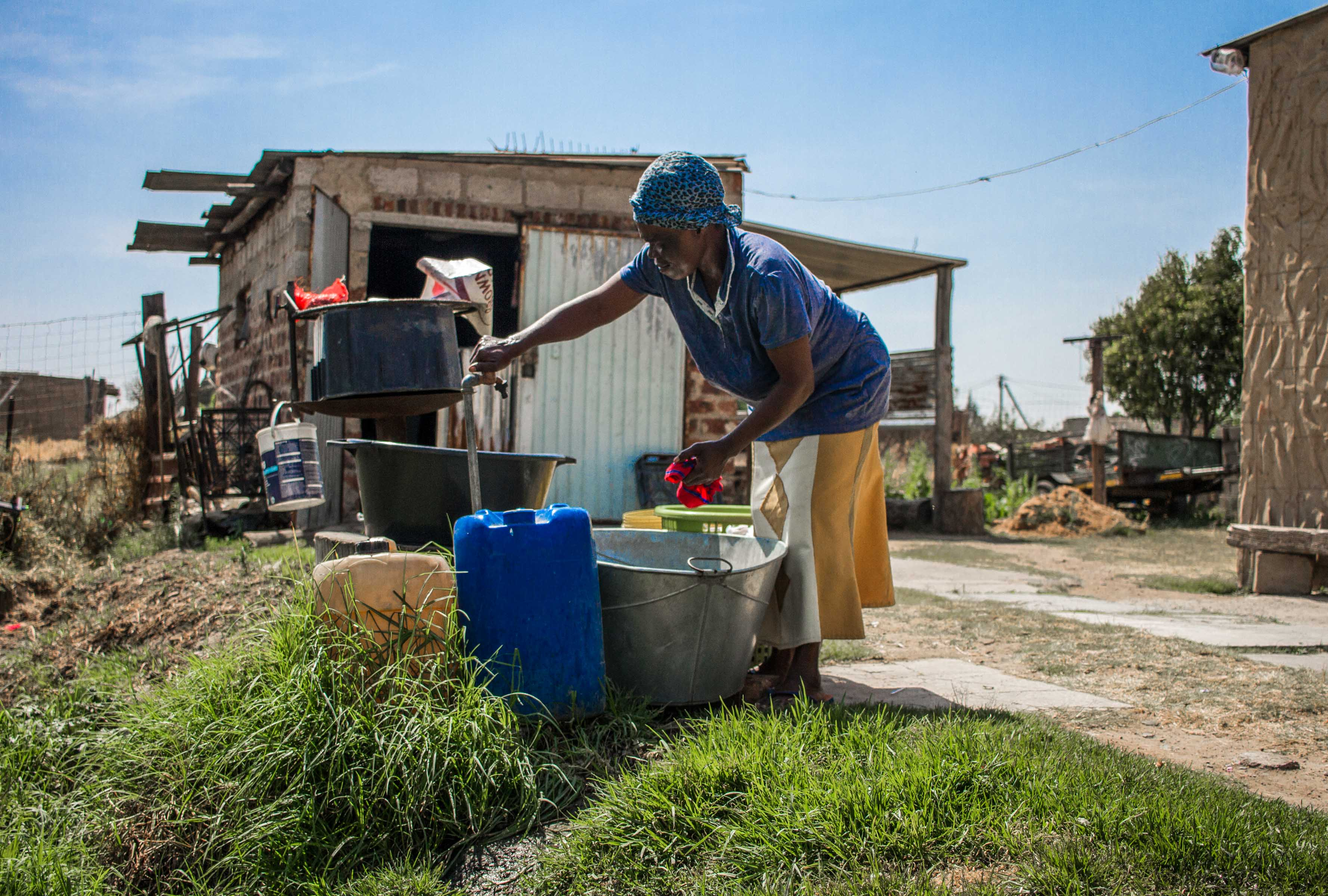 13 September 2019: Pertunia Dlamini from kwaNkomonde in Blaauwbosch near Newcastle fetching water. She feels abandoned by the municipality.