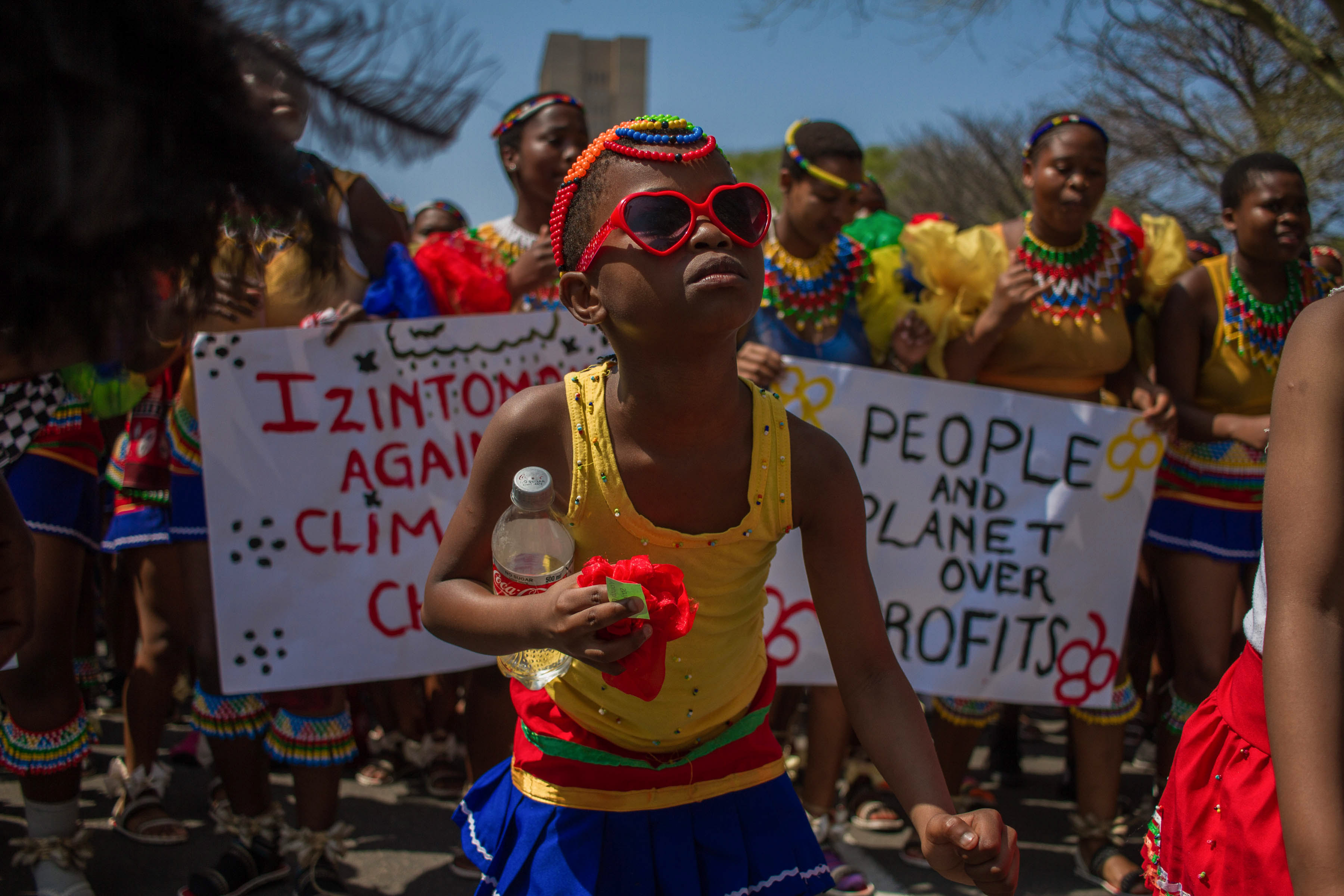 20 September 2019: Senamile Mlambo, 9, lead young women in the streets of Durban, as he chants the zulu song Sengibekezele kwaze kwasa ngibekezele, which is about about patience. (Photograph by Mlungisi Mbele)