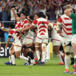 28 September 2019. The Japan team celebrate victory following the final whistle after the Rugby World Cup Group A game between Japan and Ireland at Shizuoka Stadium Ecopa in Fukuroi, Shizuoka, Japan. (Photograph by Stu Forster/Getty Images)