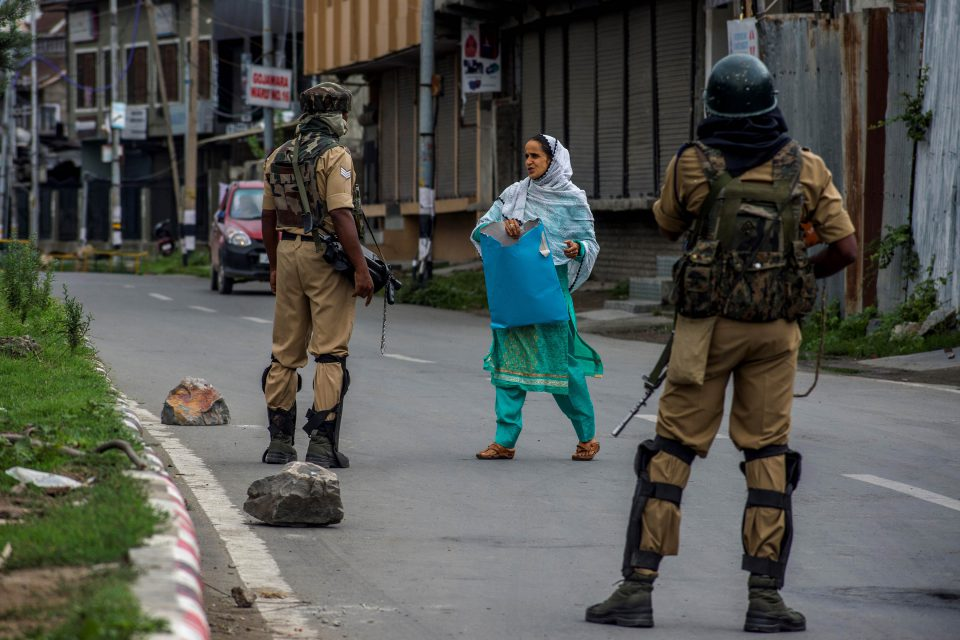 17 August 2019: Indian government forces stop a Kashmiri woman on her way to a hospital amid curfew-like restrictions in Srinagar. Critical medications are running out amid limited access to ambulance services and healthcare facilities in the region. (Photograph by Yawar Nazir/ Getty Images)
