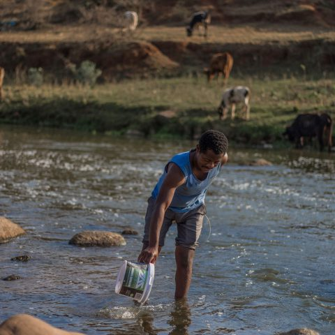 23 August 2019: Local residents such as Simphiwe Ntuli of kwaXimba near Cato Ridge still use the Dusi River to wash clothes despite it being contaminated by cooking oil and caustic soda after an accident at a factory upstream.