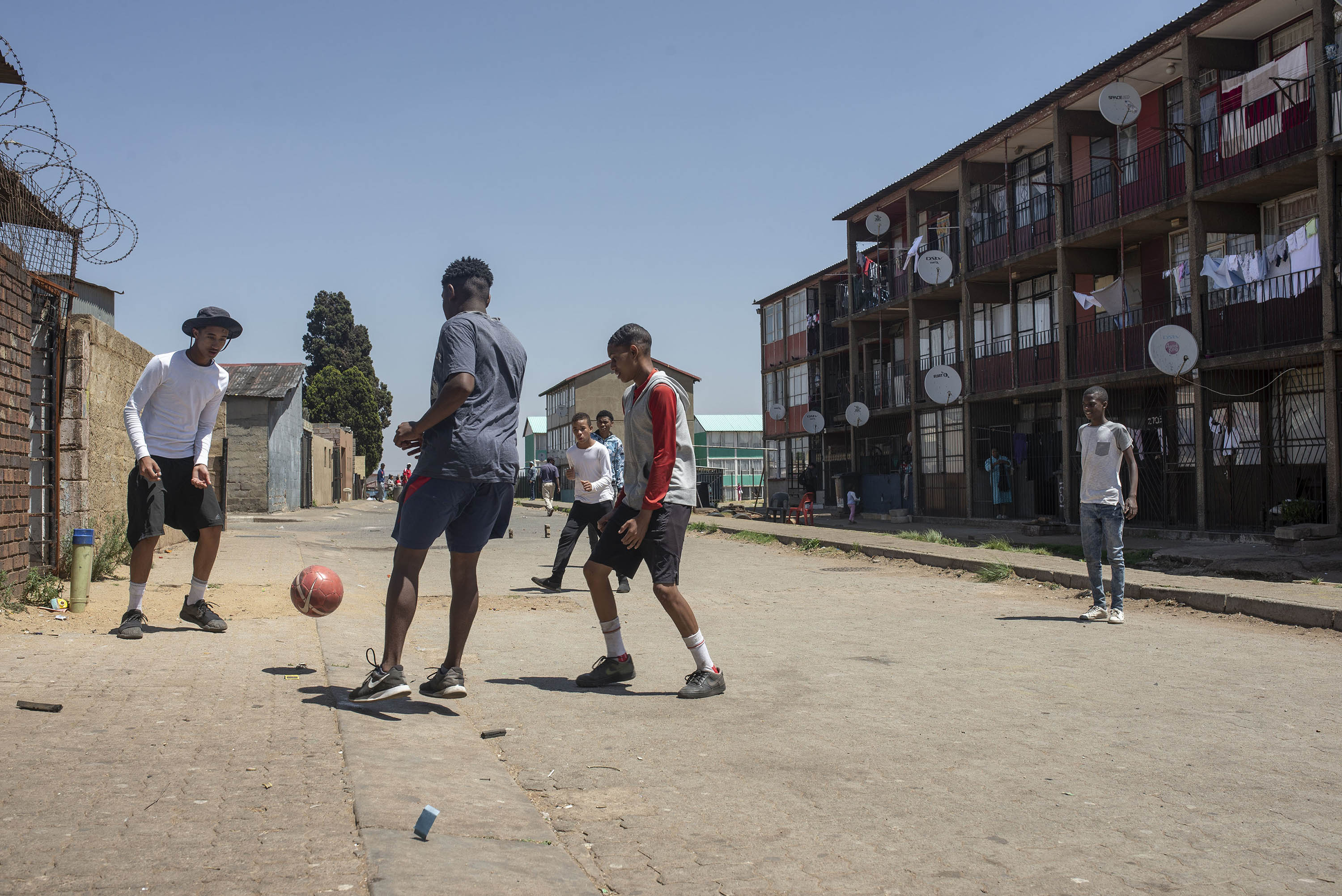 5 October 2018: Youngsters playing football in the streets of Westbury, Johannesburg, where Keagan Dolly grew up. (Photograph by Ihsaan Haffejee)