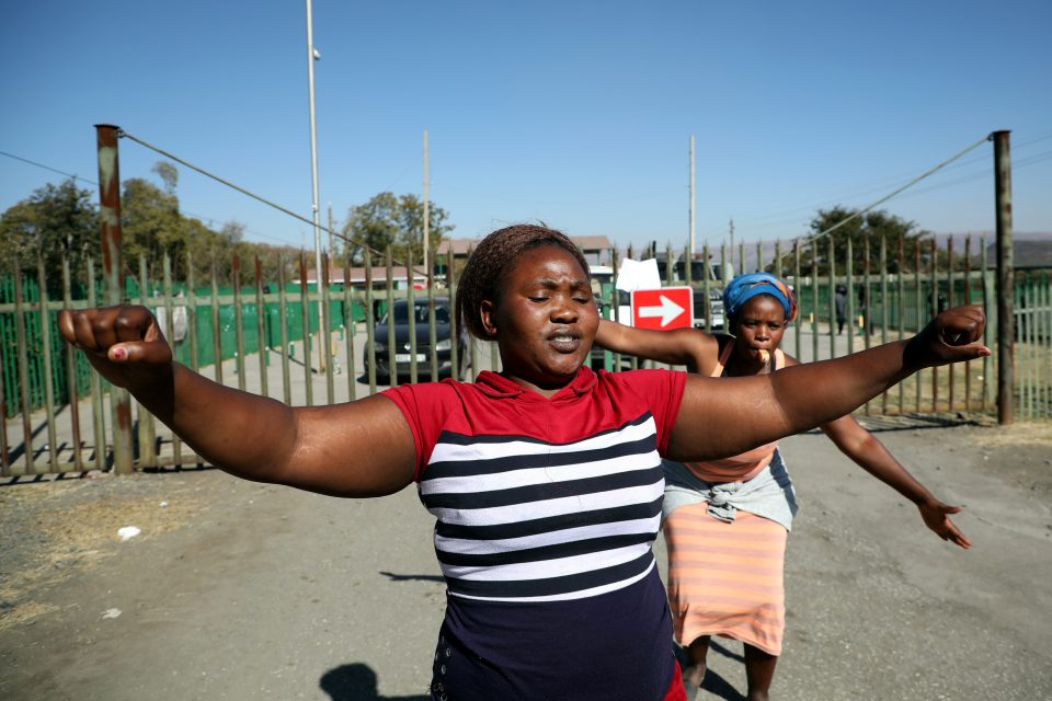 25 June 2019: Two of a group of women protesting outside the LanXess-run Rustenburg Chrome Mine, demanding that managers hear their grievances about sexual harassment in the workplace. (Photograph by Sandile Ndlovu)