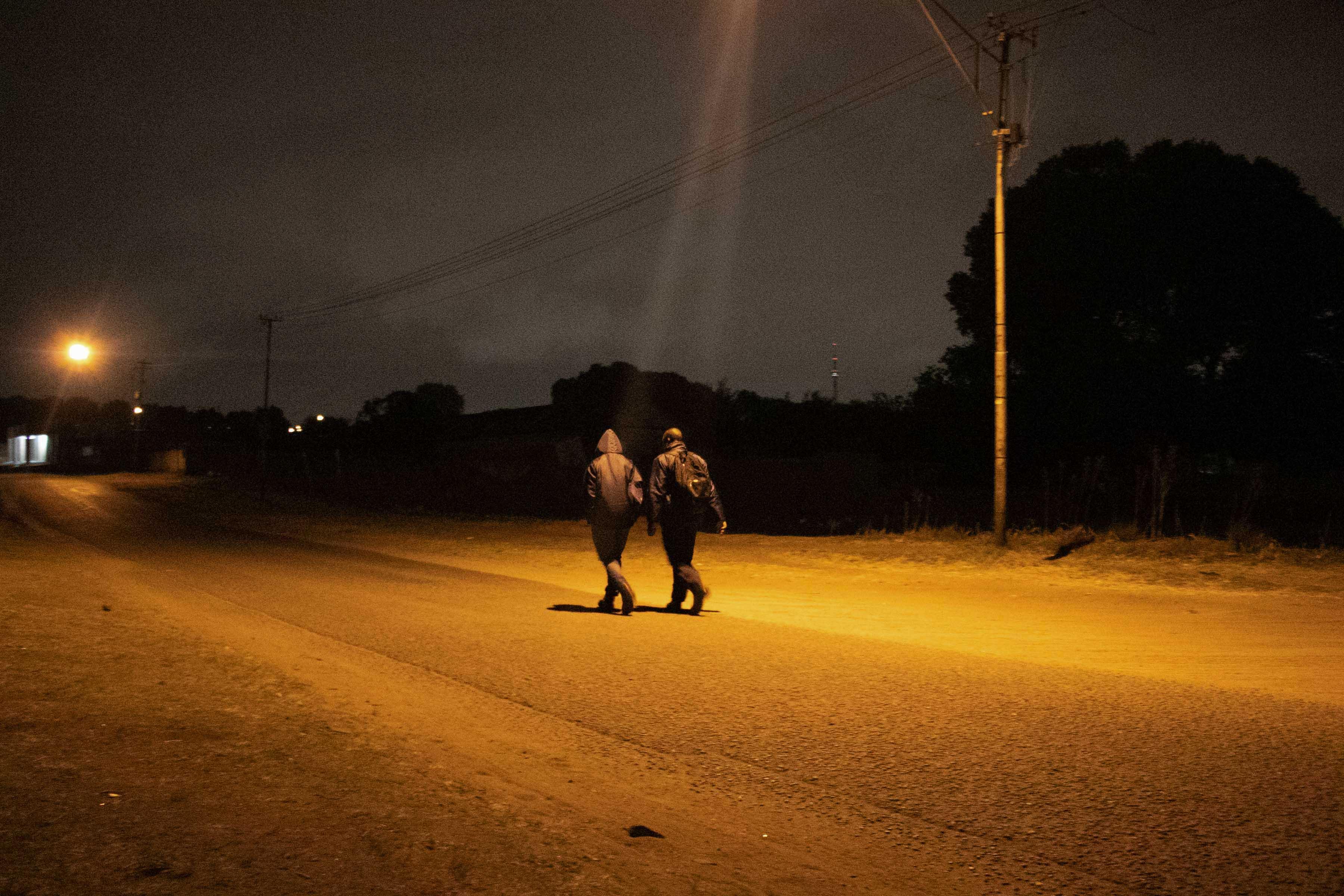 2 October 2019: Edmond Patrick Ndlovu and his housemate, Emmanuel, walking to the Langlaagte station.
