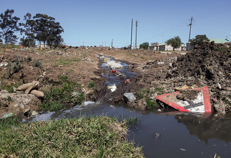 15 October 2019: Human sewage flows freely through the streets of Joza township in Makhanda. (Photograph by Anna Majavu).