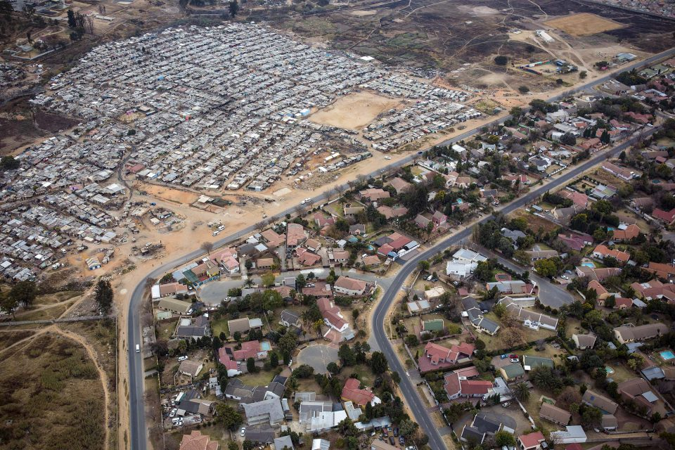 8 July 2018: Poet Lesego Rampolokeng has described the reality of impoverished people without work, such as many of those living in Kya Sands, a shack settlement north of Johannesburg, in words that portray a new kind of hell. (Photograph by Per-Anders Pettersson/Getty Images)