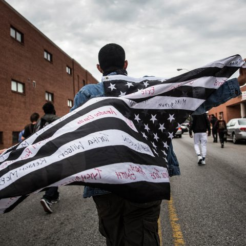 1 May 2015: Protesters march in support of Maryland state attorney Marilyn Mosby's announcement that charges would be filed against Baltimore police officers after the death of Freddie Gray in Baltimore, Maryland. (Photograph by Andrew Burton/Getty Images)