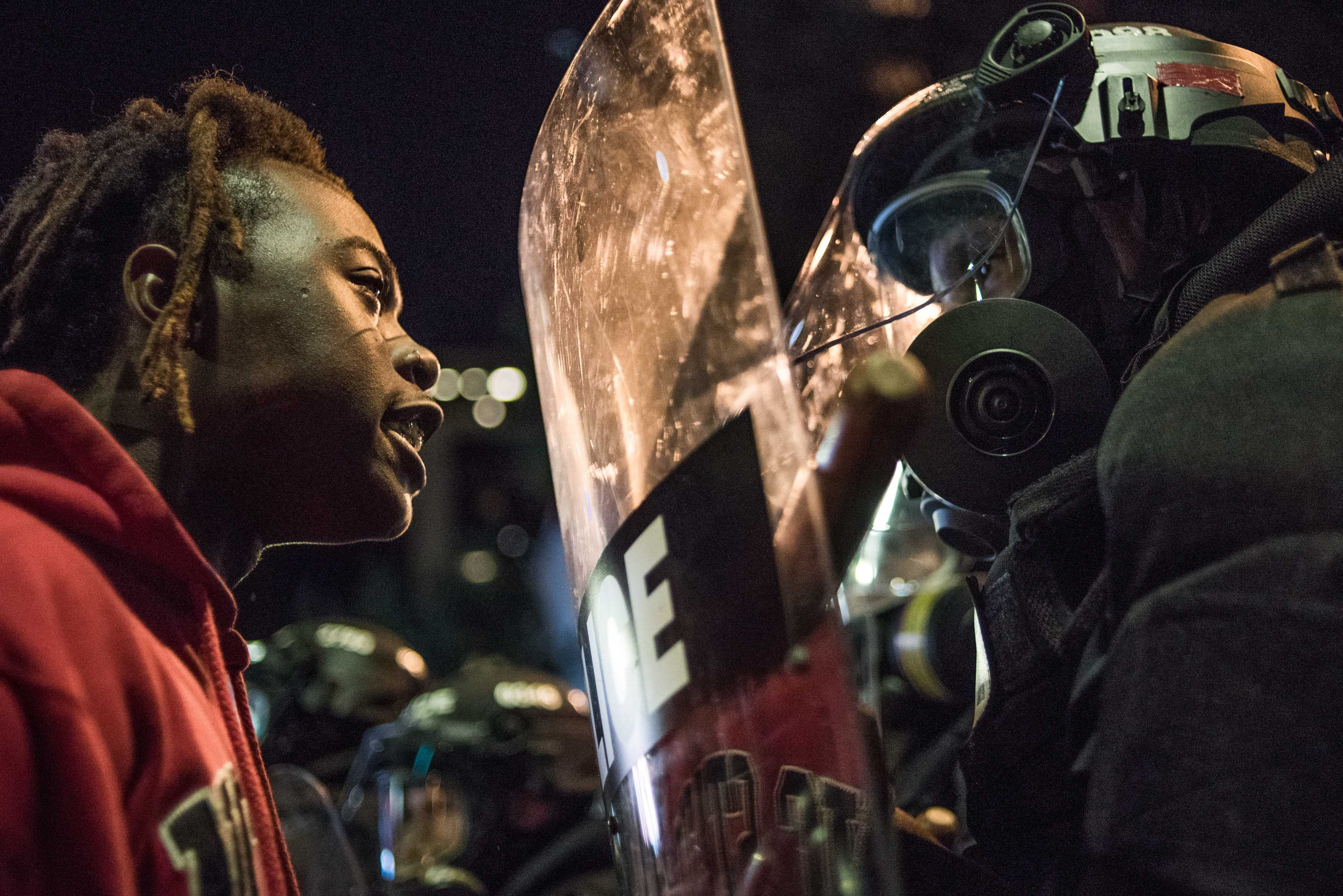 21 September 2016: A demonstrator stares down law enforcement during protests in Charlotte, North Carolina, which began in response to the fatal shooting of 43-year-old Keith Lamont Scott. (Photograph by Sean Rayford/Getty Images)