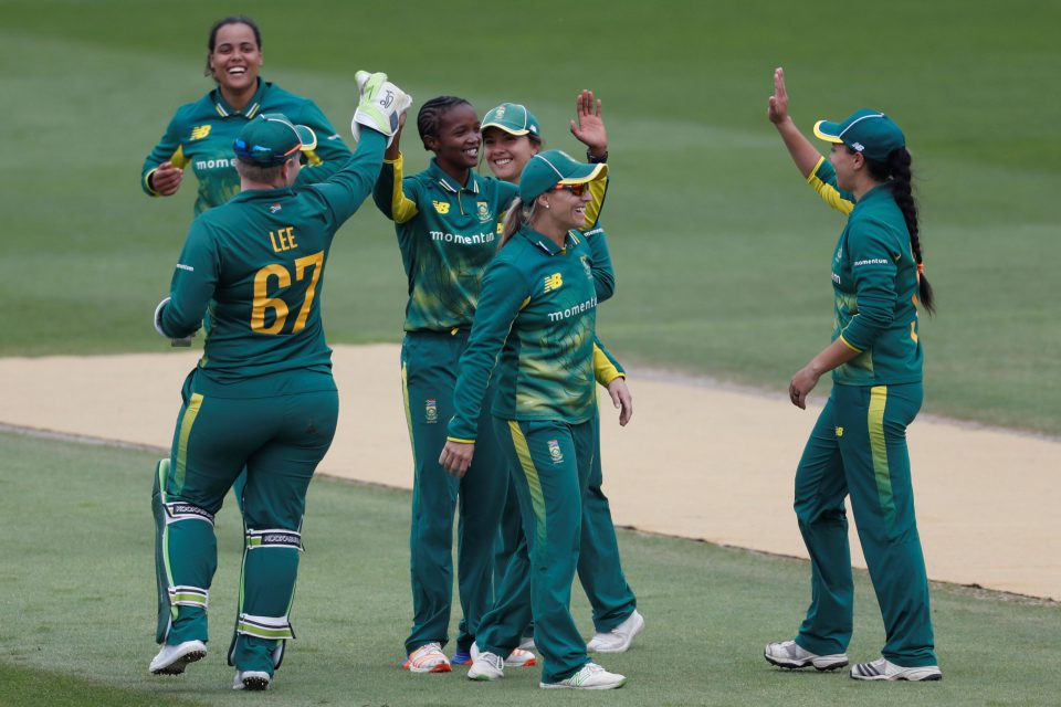 9 June 2018: Former South African captain, Ayabonga Khaka (centre), high-fives teammates after taking Tammy Beaumont's wicket. (Photograph by Action Images via Reuters/Paul Childs)