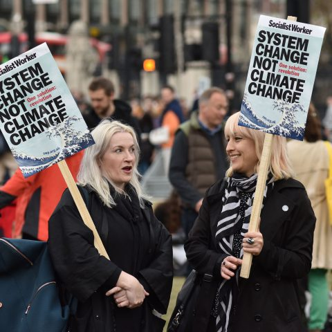 1 May 2019: Protesters holding placards demanding that the system be changed to address the climate emergency during a protest organised by trade union groups in Parliament Square in London, England. (Photograph by John Keeble/Getty Images)