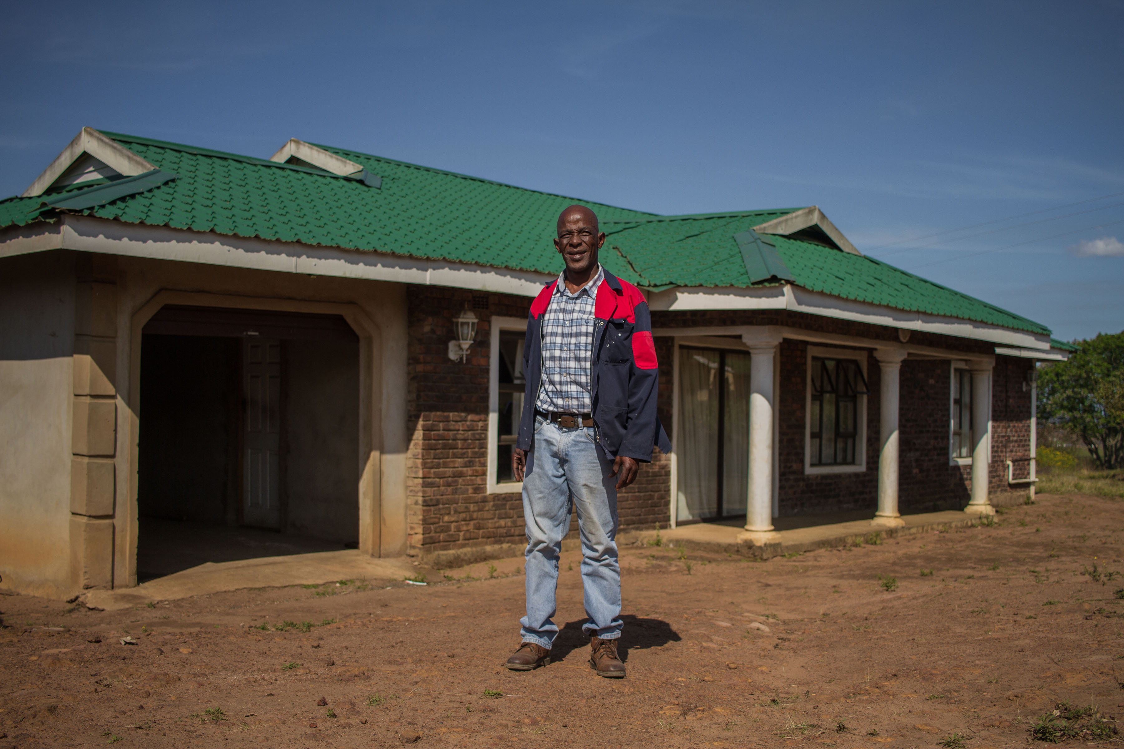 2 October 2019: Zakhele Nkwankwa outside the house he built on land for which he had permission to occupy rights, that the Ingonyama Trust then leased to him.