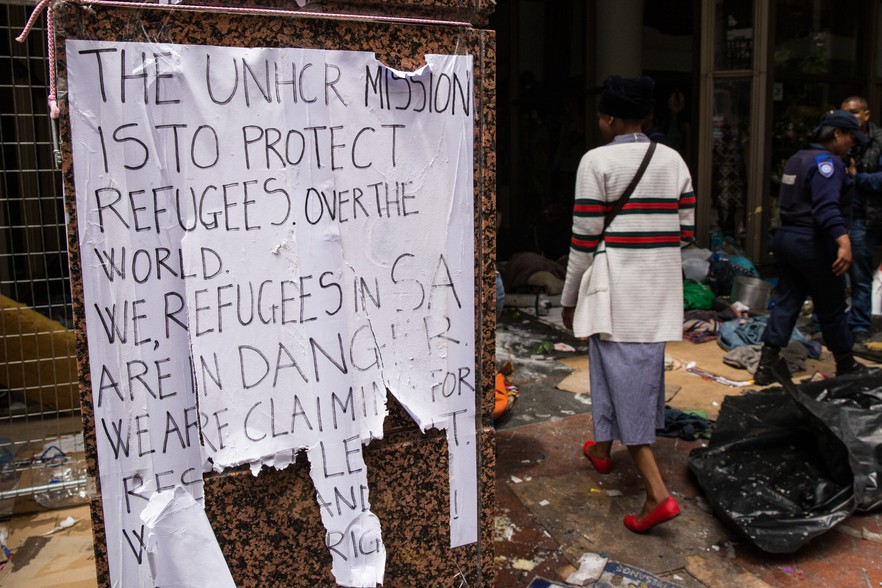 30 October 2019: The remains of a poster in central Cape Town after the police evicted refugees camped outside the United Nations High Commissioner for Refugees office with stun grenades, rubber bullets and water cannons. (Photograph by Ashraf Hendricks/GroundUp)