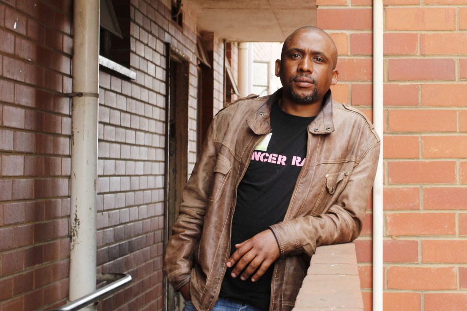 14 September 2019: Vuyolwethu Sibulali outside his room in Block R, where he stays after allegedly facing death threats and police intimidation for speaking out against violence at Glebelands Hostel in Durban. (Photograph by Nomfundo Xolo)