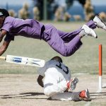 25 September 2019: A batsman from Kwazulu-Natal, in purple, jumps over a player from the Free State, in white, to avoid being run out during the 2019 Blind National Cricket Tournament.