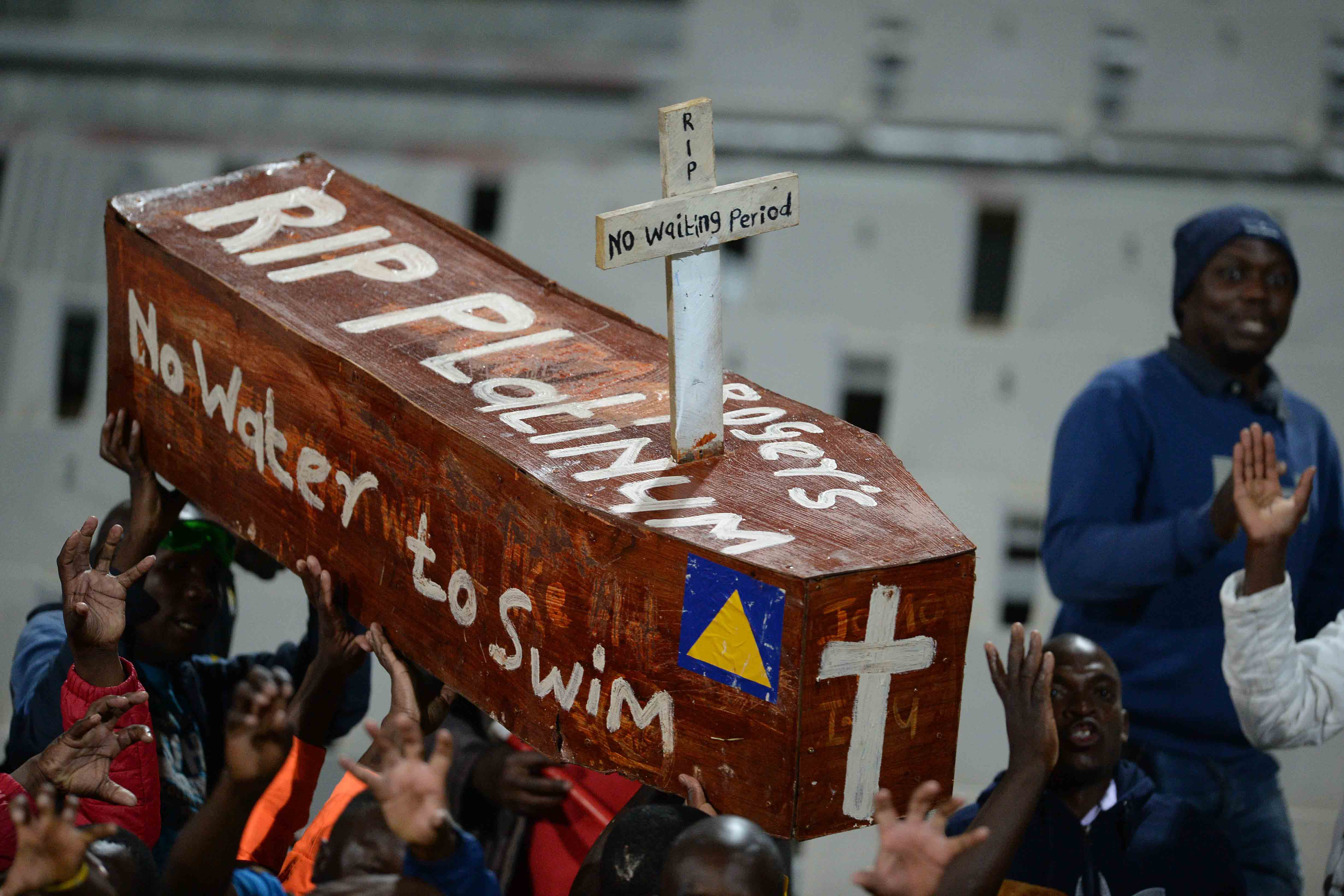 26 May 2018: Black Leopards supporters carry a coffin mourning the imminent demise of Platinum Stars during the National First Division Promotion and Relegation Playoff match between Stars and Leopards at Moruleng Stadium in Rustenburg. (Photograph by Lefty Shivambu/Gallo Images)