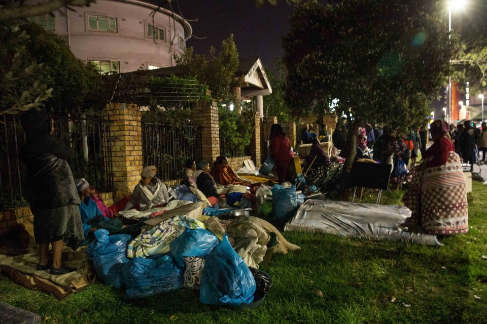 Residents spent the night outside Arcadia Place in Observatory after being evicted. Photograph by Ashraf Hendricks