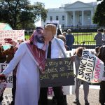 19 October 2018: A protester dressed as Saudi Arabian Crown Prince Mohammad bin Salman and another dressed as US President Donald Trump demonstrate with members of the group Code Pink outside the White House. (Photograph by Win McNamee/Getty Images)