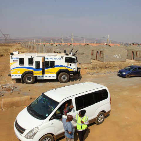 08 August 2019: Metro Police vehicles on standby as construction of RDP houses for MK veterans continues at Palm Ridge. Angry people claiming to be the rightful owners allegedly occupied the houses.