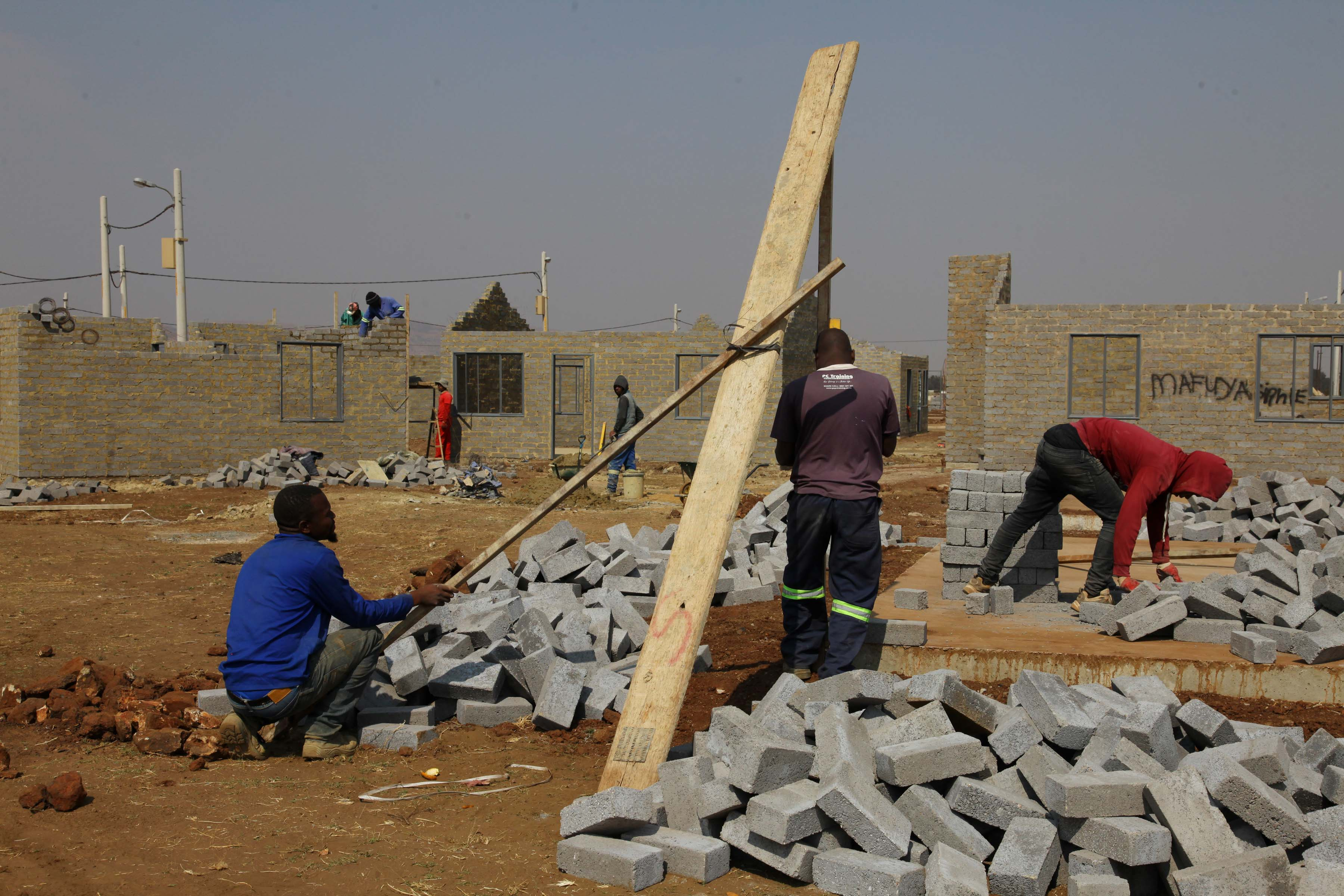08 August 2019: Workers prepare bricks on a construction site reserved to build RDP houses for MK veterans at Palm Ridge.