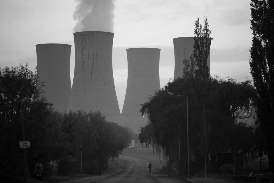 Women walking near Komati Power Station. The air quality in South Africa's Highveld region is now among the worst in the world. Komati, Mpumalanga.