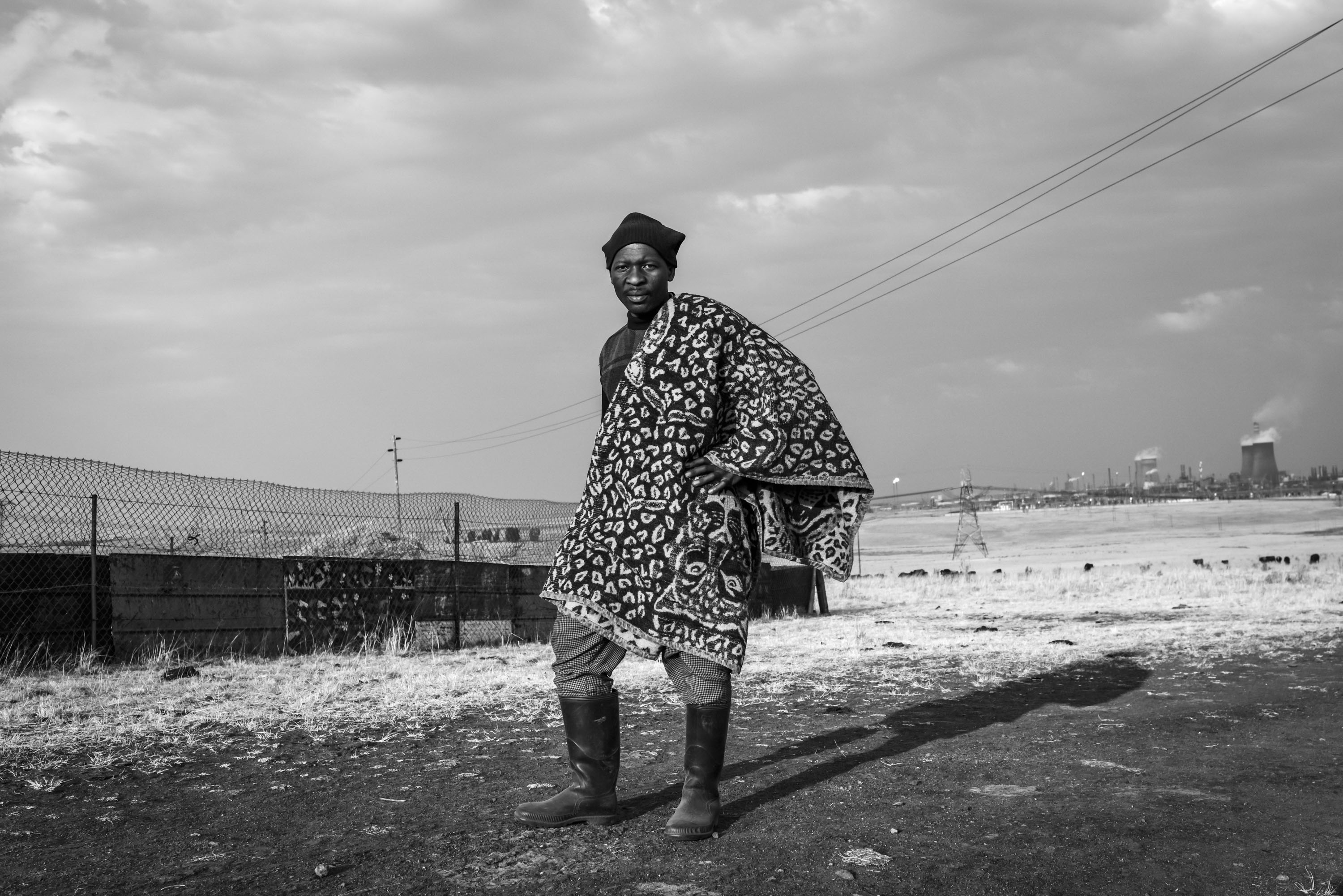 Tumisang Mafa keeps livestock on a patch of land between Secunda and eMbalenhle, near the Sasol Synfuels Plant. 'I wake up from fever and coughing when I am sleeping,' he says. eMbalenhle, Mpumalanga.