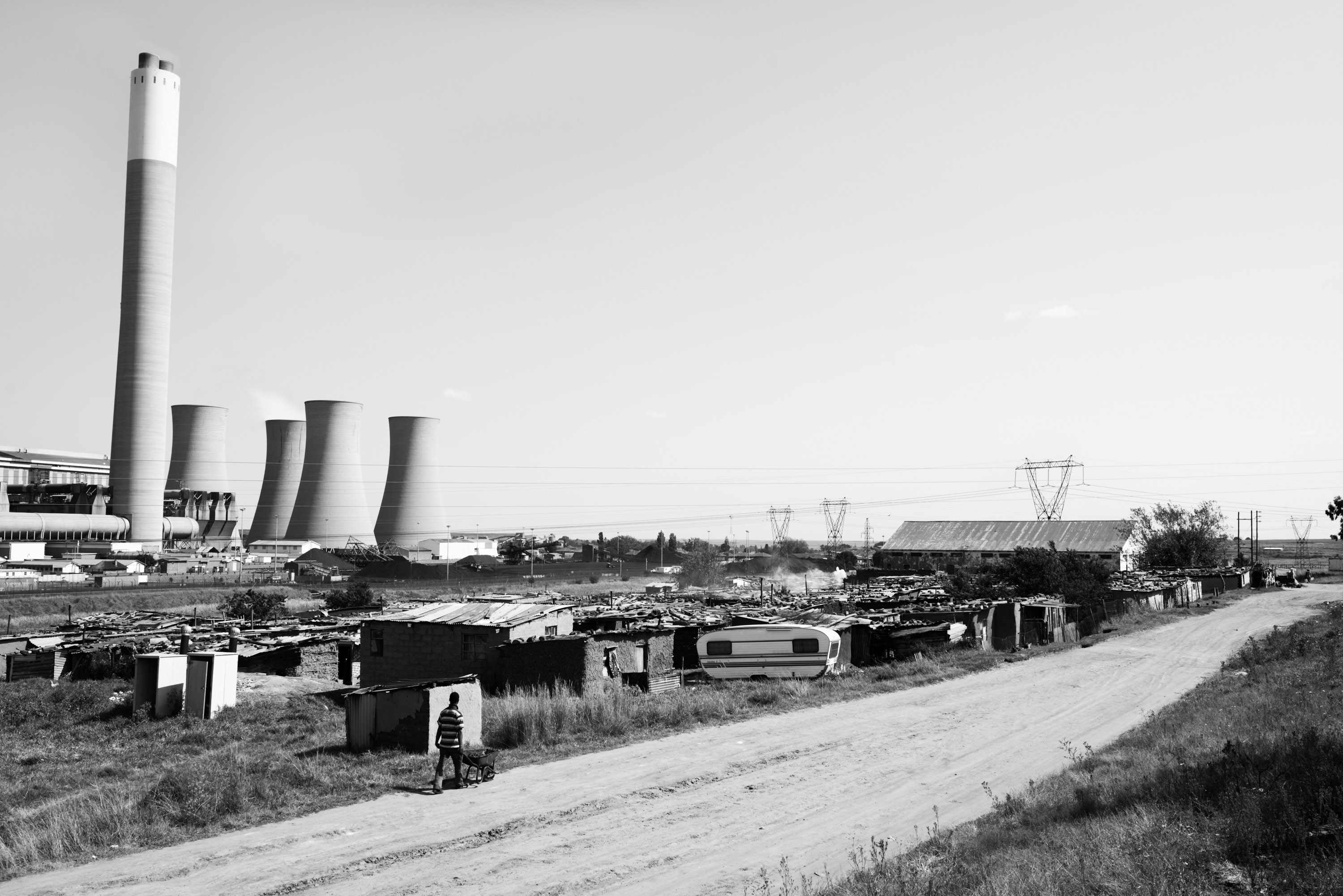 Big House, a settlement next to Komati Power Station. Despite living just a few metres from a power station, the residents of Big House have never had formal access to electricity. Komati, Mpumalanga.