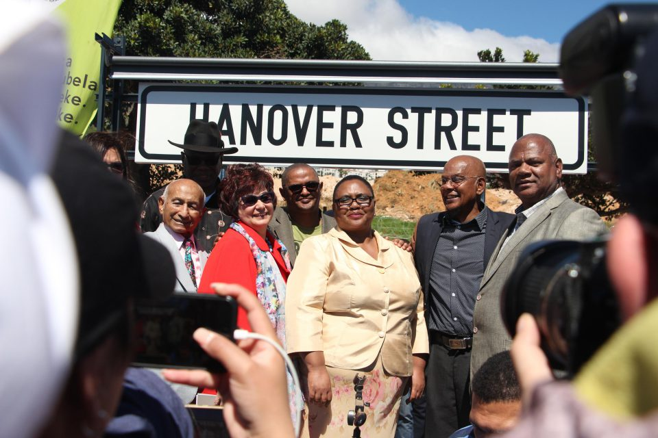 24 September 2019: Minister of Land Reform and Rural Development Thoko Didiza (centre) with Cape Town mayor Dan Plato (far right) under the new Hanover Street sign. Photographs by Yazeed Kamaldien.