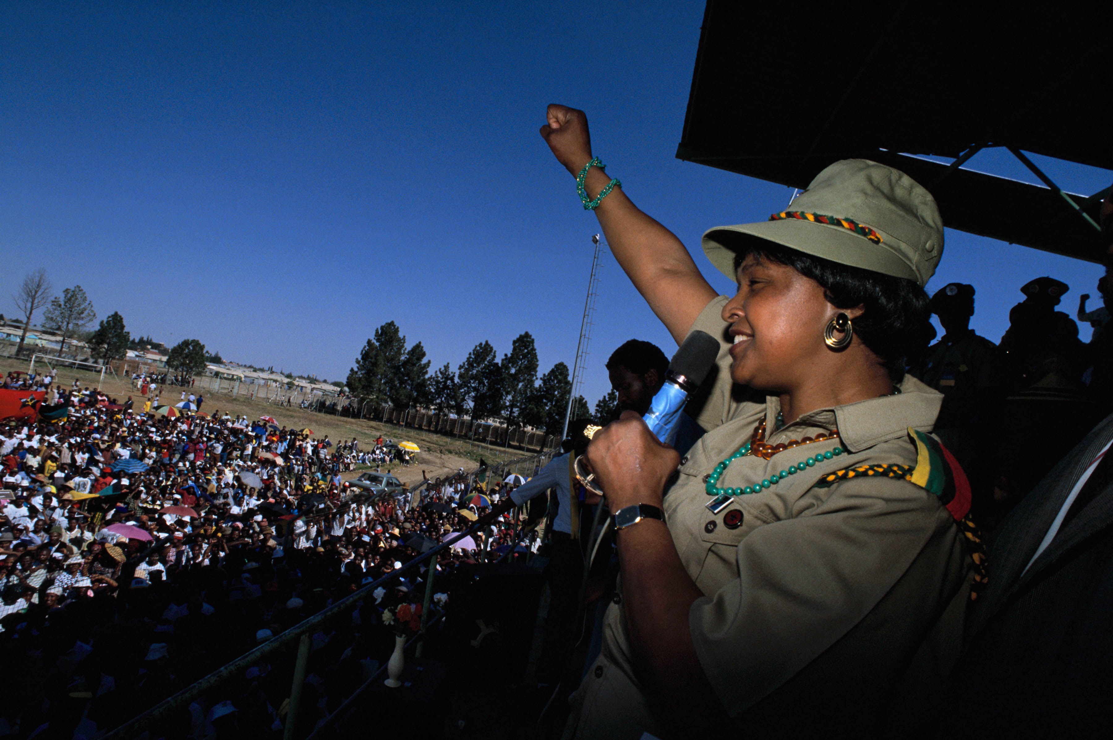 1990: Winnie Madikizela-Mandela at an ANC rally in Soweto, Johannesburg. (Photograph by Gideon Mendel/Corbis via Getty Images)