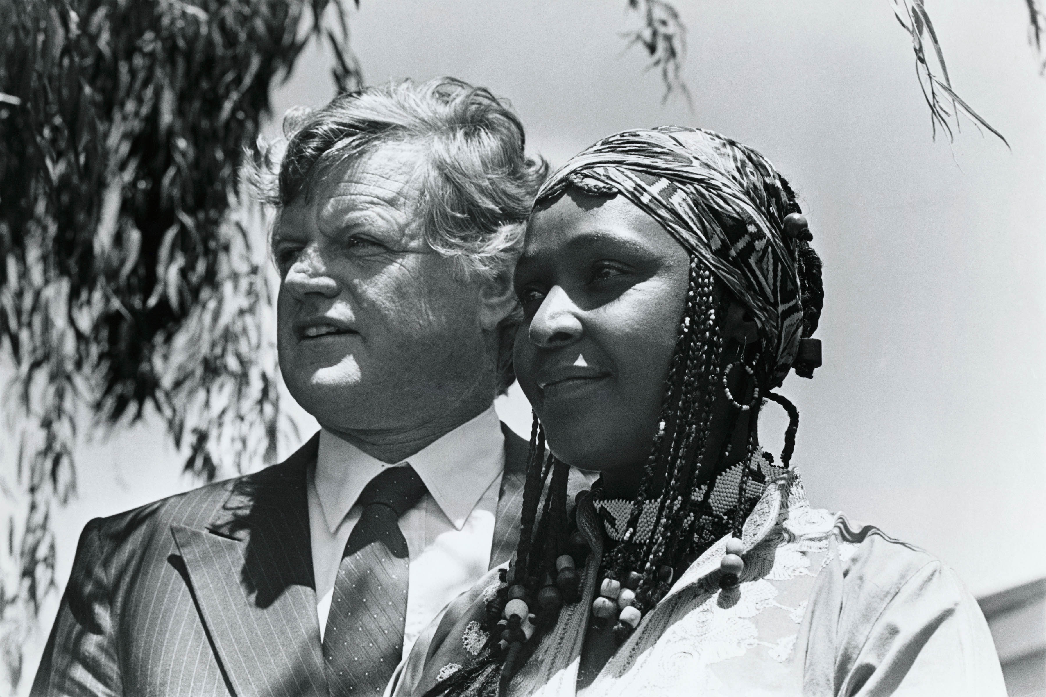 1984: United States senator Edward Kennedy with Winnie Madikizela-Mandela while she was in exile in Brandfort in the Free State, South Africa. (Photograph by Gideon Mendel/Corbis via Getty Images)