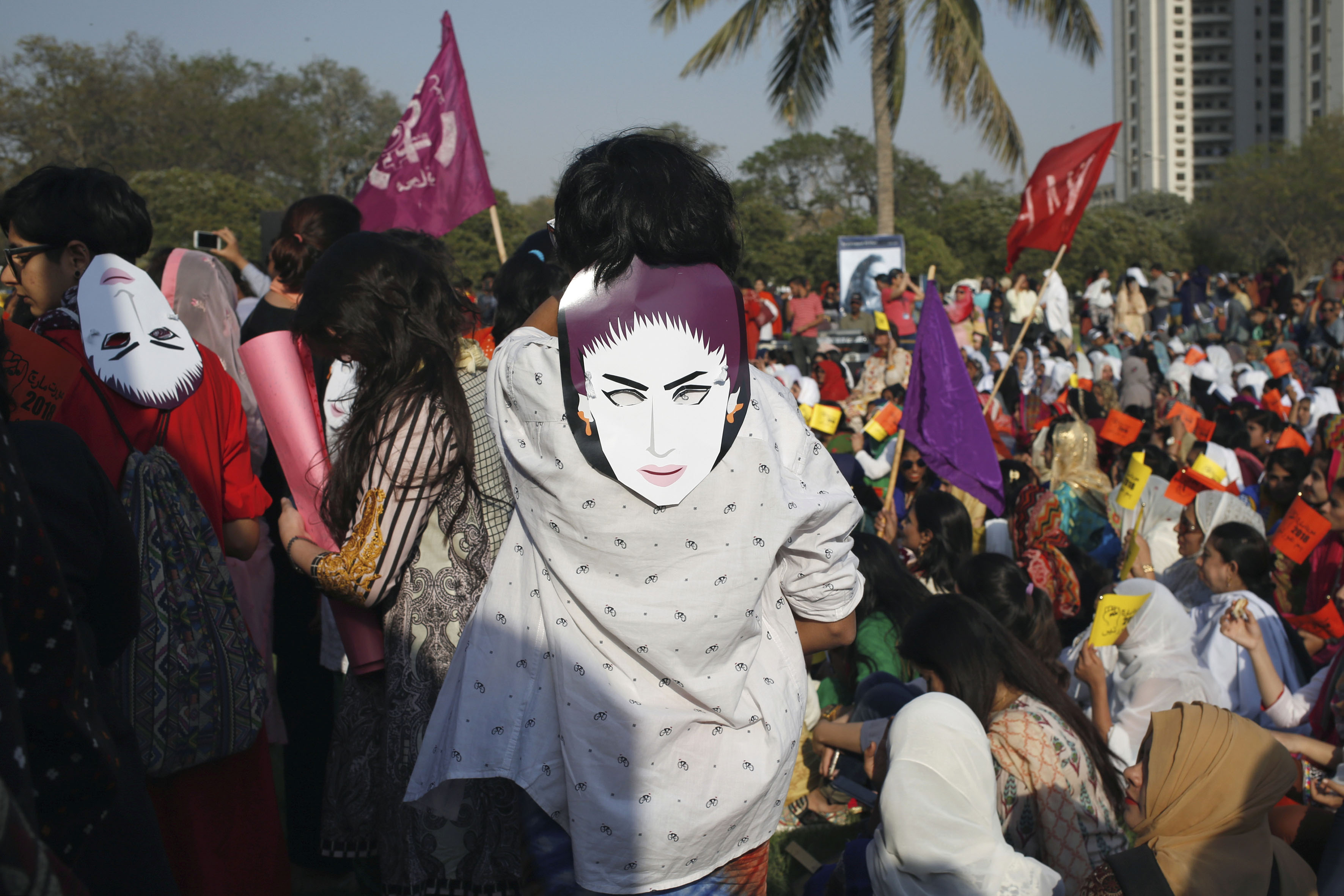 8 March 2018: People wearing masks depicting Qandeel Baloch, the social media celebrity who was strangled in an 'honour killing' in 2016, as they take part in an aurat or women's march in Karachi, Pakistan. (Photograph by Reuters/Akhtar Soomro)
