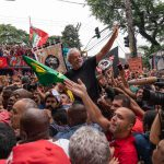 9 November 2019: Former Brazilian president Luiz Inácio Lula da Silva is carried on the shoulders of the crowd as he makes his way back to the entrance of a metalworkers' union headquarters in São Bernardo do Campo, in the south of São Paulo.