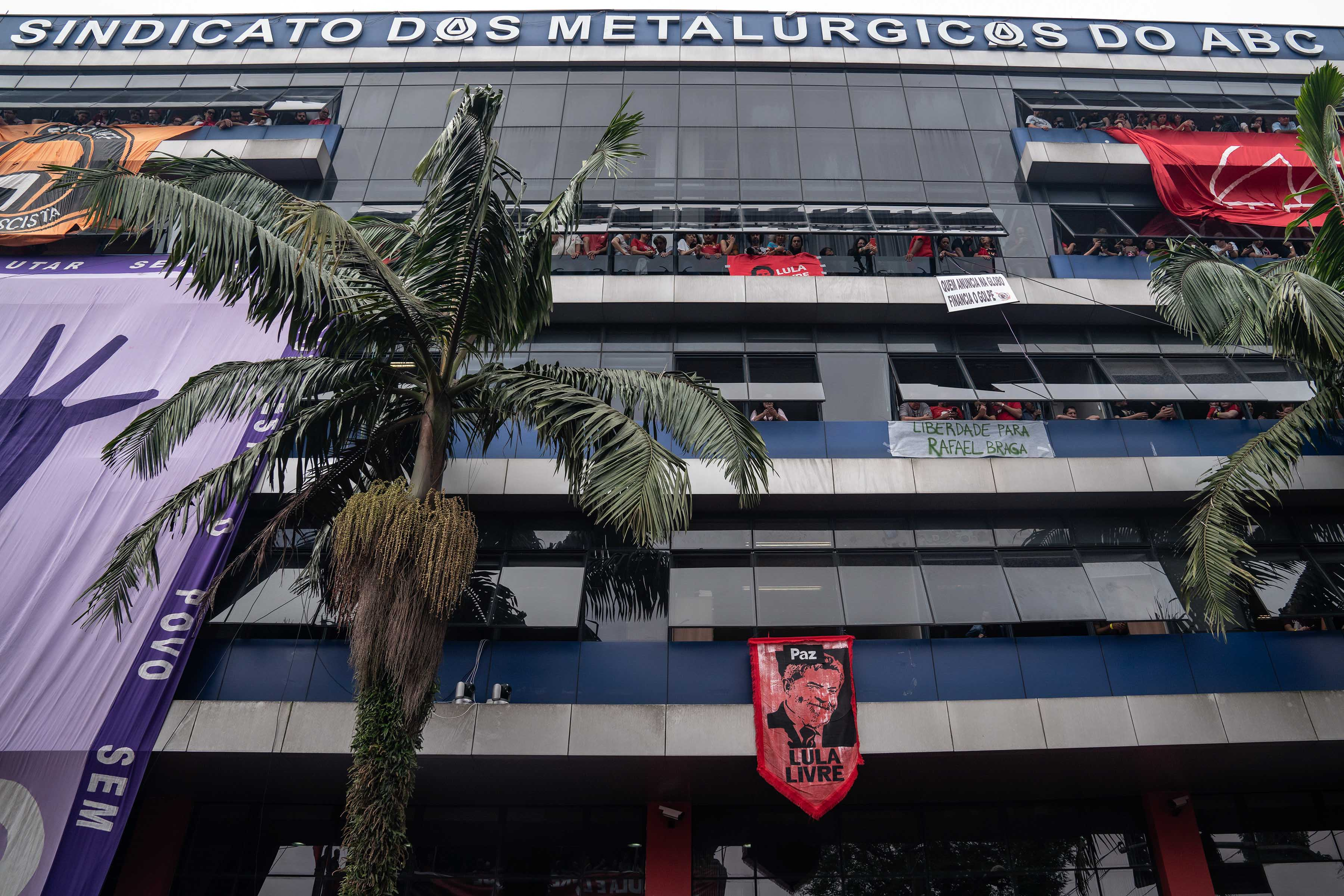 9 November 2019: People peer down from the windows of the ABC Metalworkers Union headquarters in the south of São Paulo, where a massive rally celebrated Lula's release.