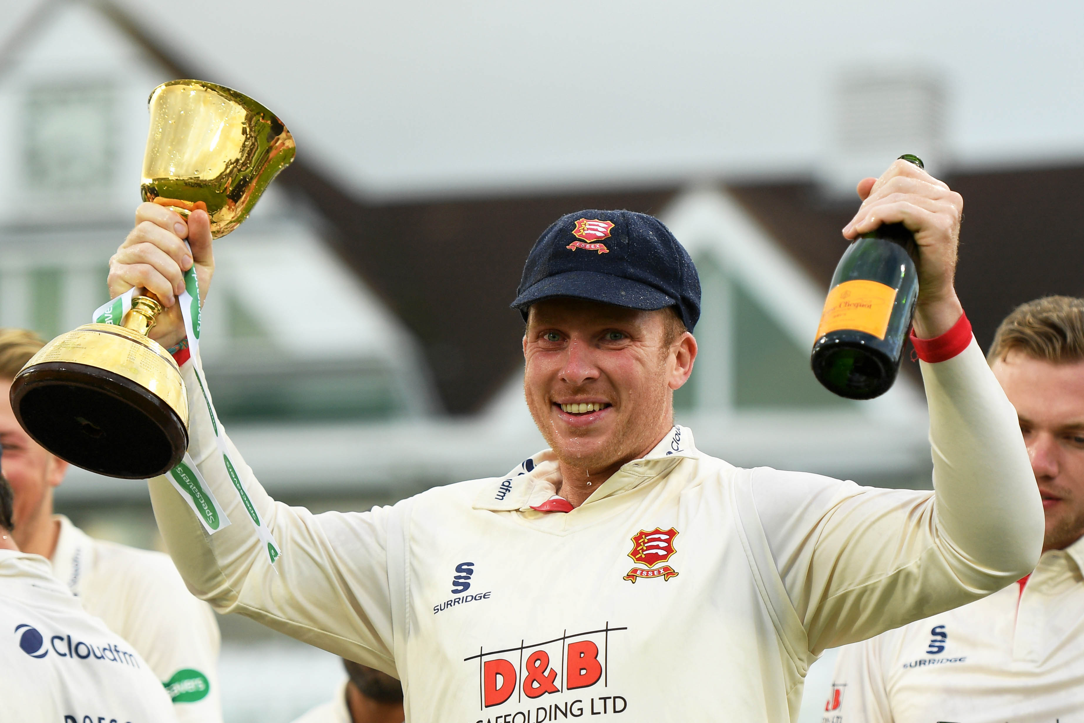 26 September 2019: Simon Harmer of Essex celebrates with the County Championship trophy during the fourth day of their County Championship match against Somerset in Taunton, England. (Photograph by Harry Trump/Getty Images)