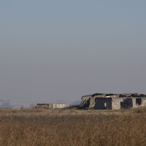 13 May 2018: An abandoned farmhouse near eMalahleni in Mpumalanga. Dispossession is historically thought about in relation to land, but relocating graves causes loss of spiritual security and sense of belonging. (Photograph by Daylin Paul)