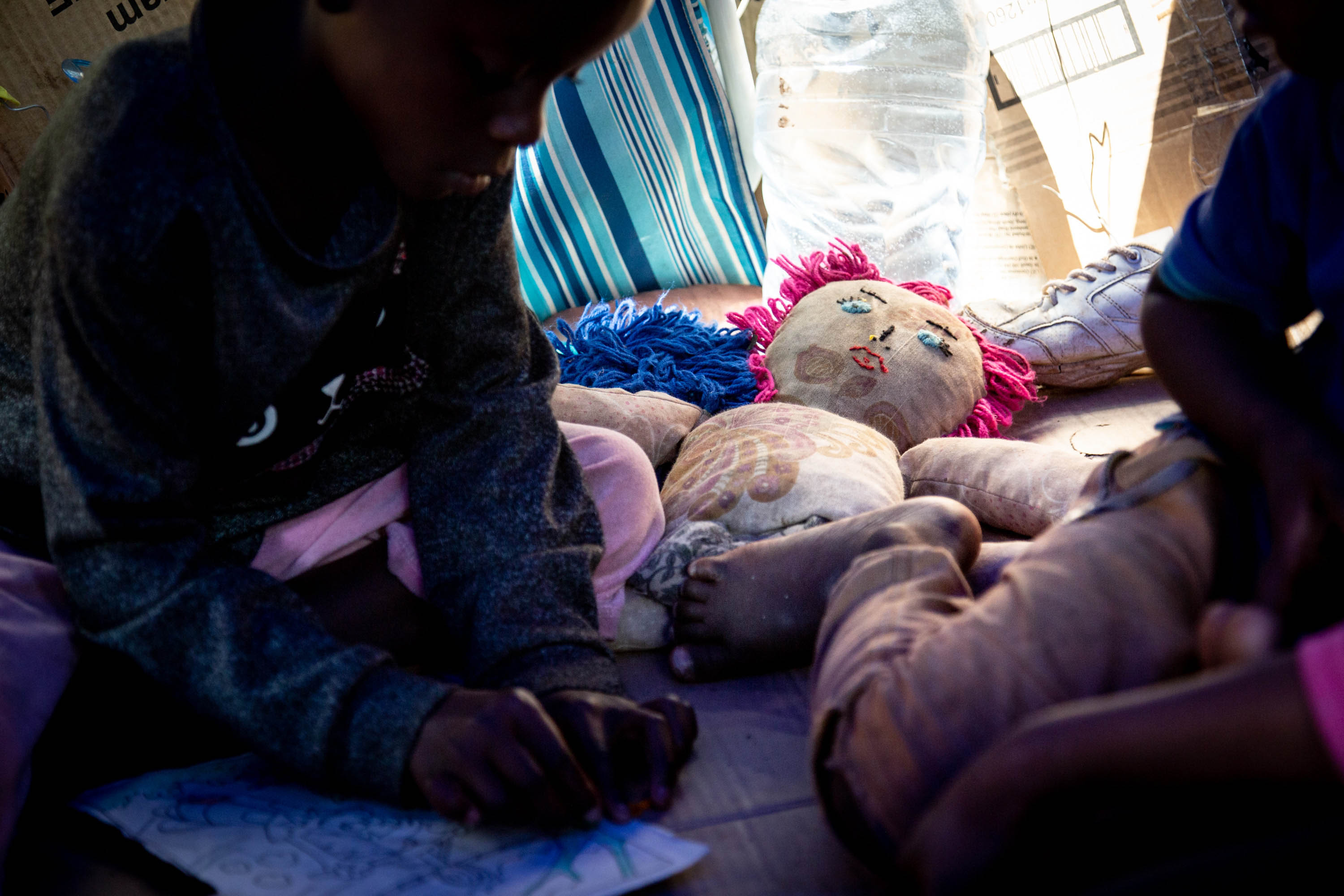 6 November 2019: Seven-year-old Shagayo Kolanda with a sibling in their mother Beatrice Faida's tent at the makeshift refugee camp in Tshwane. Born in the Democratic Republic of the Congo but without DRC papers, Shagayo has not had any schooling in South Africa.