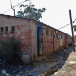 17 October 2019: One of the communal toilets shared by residents in KwaMashu Hostel. The toilets are unisex and are used by adults and children. Blocked pipes and drains have been ignored for years. A pool of raw sewage stagnates next to the toilets. (Photographs by Nomfundo Xolo)