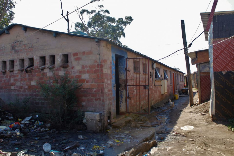 17 October 2019: One of the communal toilets shared by residents in KwaMashu Hostel. The toilets are unisex and are used by adults and children. Blocked pipes and drains have been ignored for years. A pool of raw sewage stagnates next to the toilets.