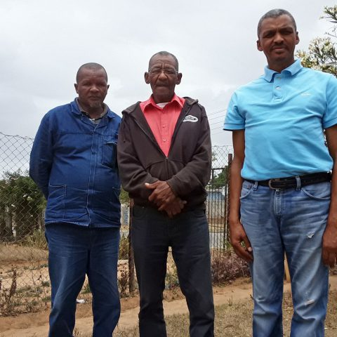 8 November 2019: (From left) Vuyisile Kula, Kiewiet Stuurman and JD Cyster, workers at Volkswagen South Africa, were dismissed in 2000. (Photograph by Anna Majavu)