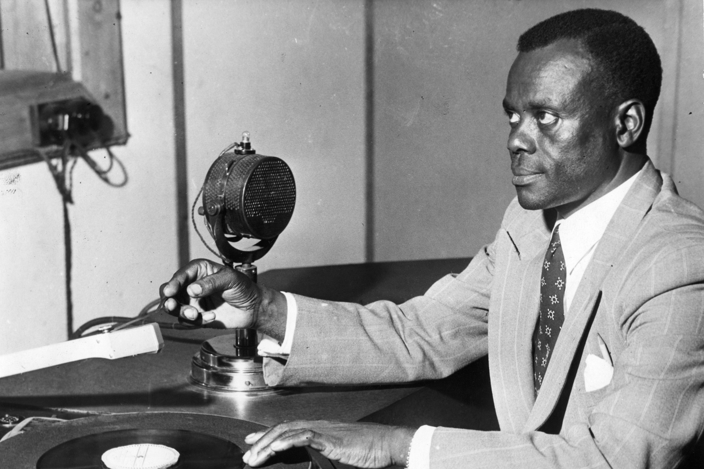 April 1955: King Edward Masinga broadcasts the Durban SABC's Bantu Programme. He composed songs, wrote radio plays in isiZulu and translated many English plays into isiZulu for broadcasting. (Photograph by Drum photography / BAHA)